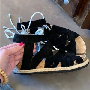 Free People black suede-leather lace-up sandals.